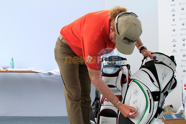 Miguel Angel Jimenez (ESP) signs bags for charity after finishing his round in the Pro-Am Day of the BMW International Open at Golf Club Munchen Eichenried, Germany, 22nd June 2011 (Photo Eoin Clarke/www.golffile.ie)
