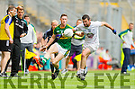 Jonathan Lyne,  Kerry in action against Padraig O'Neill,  Kildare in the All Ireland Quarter Final at Croke Park on Sunday.