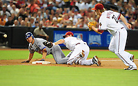 Jul 18, 2008; Phoenix, AZ, USA; Los Angeles Dodgers baserunner Jeff Kent looks on as Arizona Diamondbacks shortstop Stephen Drew loses the ball while trying to make the tag at third base in the first inning at Chase Field. Mandatory Credit: Mark J. Rebilas-
