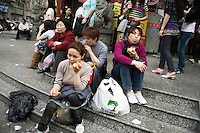 Shoppers wait outside of a market selling fake designer clothing in Shanghai, China.