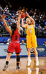 BROOKINGS, SD - NOVEMBER 12:  Madison Guebert #11 from South Dakota State University shoots over Nakiah Bell #2 from Southern Illinois Edwardsville at Frost Arena November 13, 2016 in Brookings, South Dakota. (Photo by Dave Eggen/Inertia)