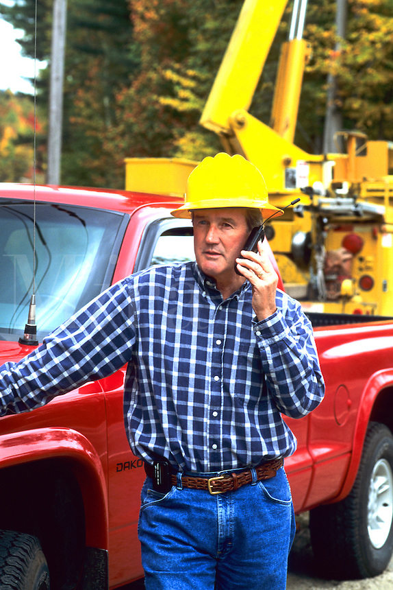 Construction worker talking on portable phone on job site