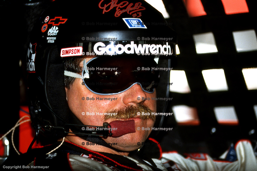 DARLINGTON, SC - MARCH 29: Dale Earnhardt waits to drive during practice for the TranSouth 500 on March 29, 1992, at the Darlington Raceway near Darlington, South Carolina.