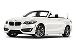 Stock pictures of low aggressive front three quarter view of a 2018 BMW 2 Series 230i Sport Line 2 Door Convertible