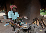 "Joyce Dzongololo cooks sorghum porridge for breakfast in Chidyamanga, a village in southern Malawi that has been hard hit by drought in recent years, leading to chronic food insecurity, especially during the ""hunger season,"" when farmers are waiting for the harvest."