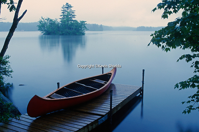 Canoe on a dock at Kezar Lake, Lovell, Oxford County, Maine, USA.