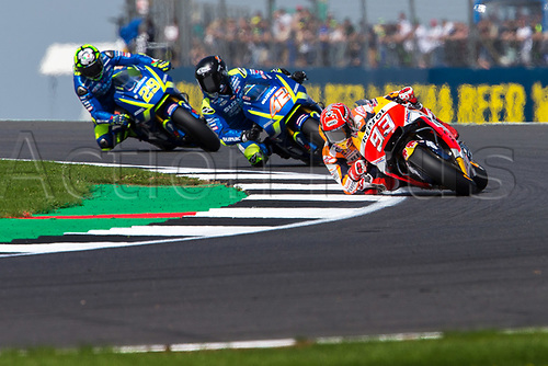 26th August 2017, Silverstone Circuit, Northamptonshire, England; British MotoGP, Qualifying; Repsol Honda Team MotoGP rider rider Marc Marquez followed by Team Suzuki Ecstar MotoGP rider Alex Rins and Team Suzuki Ecstar MotoGP rider Andrea Iannone