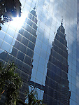 Reflections of the Petronas Twin Towers in a glass facade.