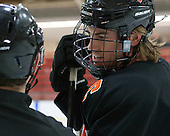 Jack Berger (Princeton - 9) chats with Jean-Yves Roy. - The Harvard University Crimson defeated the Princeton University Tigers 3-2 on Friday, January 31, 2014, at the Bright-Landry Hockey Center in Cambridge, Massachusetts.
