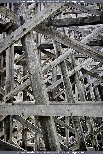 Trestle bridge abstract wooden framework structure closeup of details background
