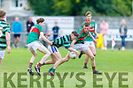 St Brendans Jerome Daly well marked by Shane Evans and Tadhg Evans of Mid Kerry in the Minor Football Championship quarter final.