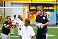 Chris Albright of the New York Red Bulls teaches students during a soccer clinic prior to a press conference announcing former President Bill Clinton (not pictured) as the honorary chairman of the USA Bid Committee to host the FIFIA World Cup in 2018 or 2022 at the FC Harlem Field in Harlem, NY, on May 17, 2010.