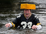 Water drips from Ken Kietter's cheesehead after he jumped into the Burley Lagoon during the 24th annual Polar Bear Jump in Olalla, Washington on January 1, 2008. This was Kietter's eight year jumping into the lagoon on New Years Day. Jim Bryant Photo. ©2010. ALL RIGHTS RESERVED.