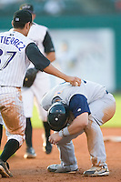 Charlotte third baseman Gustavo Molina (38) is tagged out by Louisville first baseman Jesse Gutierrez (37) after being picked off first base at Louisville Slugger Field in Louisville, KY, Tuesday, June 5, 2007.