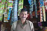 A shopkeeper in the village of Chansari in the mountains above Kullu in the Kullu Valley, Himachal Pradesh, India.