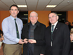 Alan Smith and Michael Coyle from the O'Raghallaigh's GFC present Fr Sean Ryan with a specially commissioned medal for all his support to the club at the Barbican centre after his retirement mass in St Peter's church West Street. Photo: Colin Bell/pressphotos.ie