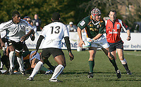 ... of South Africa looks to pass to a colleague while Fiji's Seremaia Tagicakibau prepare a tackle in the pool game of the `under 19 RWc at Harlequins, Belfast.