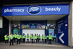 """© Joel Goodman - 07973 332324 . 26/03/2011 . London , UK . Police stand guard outside a shuttered branch of Boots in Piccadilly Circus . Hundreds of thousands of people attend an anti cuts demonstration under the banner """" March for the Alternative """" in central London , in protest at the coalition government's austerity measures . Photo credit : Joel Goodman"""