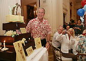 Washington, D.C. - July 4, 2006 -- United States President George W. Bush is presented with a birthday cake Tuesday evening, July 4, 2006, during a dinner party at the White House in Washington, D.C.   The President  will celebrate his 60th birthday on Thursday, July 6, 2006. .Credit: Shealah Craighead - White House via CNP