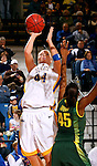 BROOKINGS, SD - NOVEMBER 23rd, 2008 : Jennifer Warkenthien of South Dakota State hits a two pointer over the hands of Oregon defender Lindsey Saffold during their game Sunday afternoon at Frost Arena on the campus of South Dakota State University in Brookings, SD. (Photo By Ty Carlson/Inertia)
