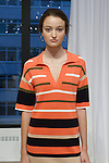 Model wears outfit and earings from the Ann Taylor Spring Summer 2017 collection by Austyn Zung, at the Ann Taylor showroom in 7 Times Square, New York on October 26, 2016.