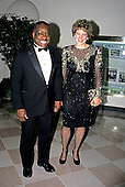 Associate Justice of the United States Supreme Court Clarence Thomas and his wife, Virginia, arrive at the White House in Washington, DC for the State Dinner honoring President Carlos Menem of Argentina on Thursday, November 14, 1991.<br /> Credit: Ron Sachs / CNP