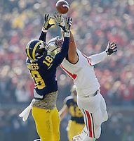 Michigan Wolverines defensive back Blake Countess (18) intercepts a pass meant for Ohio State Buckeyes tight end Nick Vannett (81) at Michigan Stadium in Ann Arbor, MI on November 30, 2013.  (Chris Russell/Dispatch Photo)