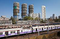 High rise developments by Mahalaxmi Station and the Western Railways train of the Mumbai Suburban Railway, India