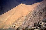 Berber village and farm terraces in mountain valley, Atlas Mountains, near Imlil, Morocco