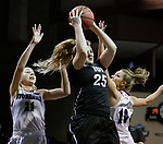 SIOUX FALLS, SD: MARCH 19: Maura D'Anna #25 of Indiana (PA) drives past Stonehill defenders Samantha Hyslip #21 and Jennifer Worden #10 during their game at the 2018 Division II Women's Elite 8 Basketball Championship at the Sanford Pentagon in Sioux Falls, S.D. (Photo by Dick Carlson/Inertia)
