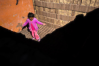 A Peruvian girl works with her father inside a kiln at a brick factory in the outskirts of Puno, Peru, 6 August 2012. Child labour is a common practice at the artisanal brick factories, found predominantly in socially deprived areas of the urban zones. Poverty and lack of employment force parents, mainly season workers coming from rural areas of the country, to employ their own children, in an effort to ensure the livelihood for the whole family. Children aged 4-7 take part in simple jobs while children aged 8 and up tend to work regularly, same as adults. A family group, consisting of 2 adults and 2-3 children, may earn 20-25 USD per day, working almost the whole day, often in harsh climatic conditions.
