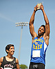 Roosevelt senior Joshua Stevenson, right, acknowledges the cheers of the crowd after winning the boys' 400 meter intermediate hurdles event on his home field in the Nassau County Class A varsity track and field championships at Roosevelt High School on Friday, May 29, 2015.<br /> <br /> James Escher