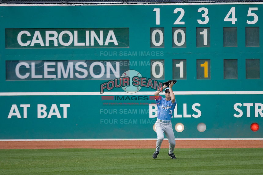 Ben Bunting #3 of the North Carolina Tar Heels makes a catch in front of the manual scoreboard at Durham Bulls Athletic Park May 23, 2009 in Durham, North Carolina. The Tigers defeated the Tar Heals 4-3 in 11 innings.  (Photo by Brian Westerholt / Four Seam Images)