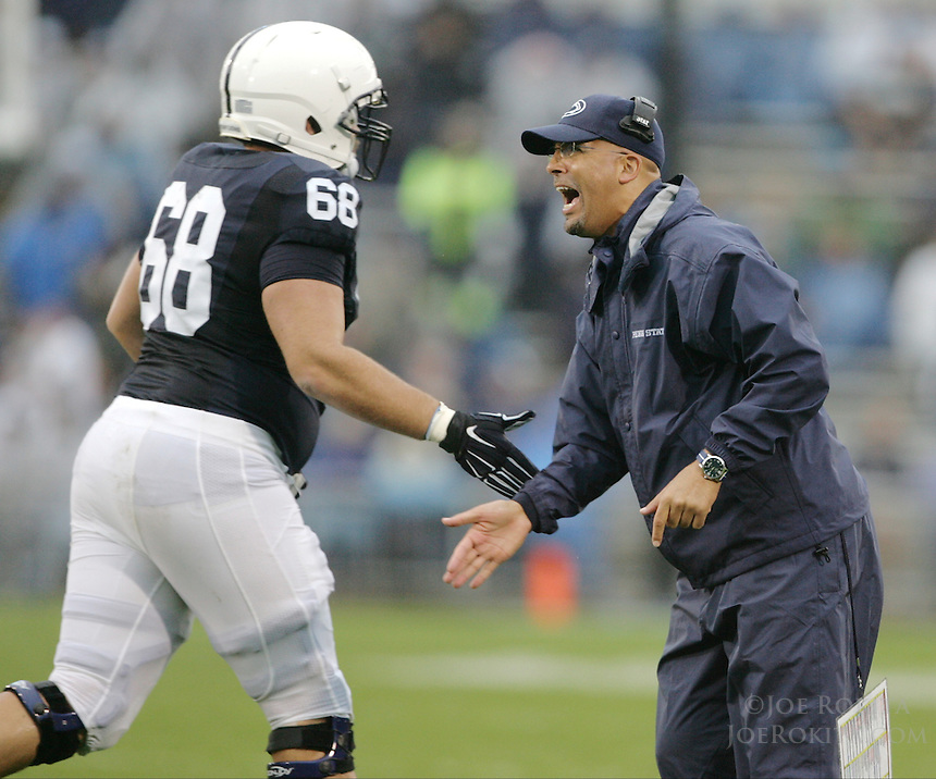 State College, PA - 09/12/2015:  Penn State head coach James Franklin congratulates OL Kevin Reihner after a Nittany Lion score. Penn State defeated Buffalo by a score of 27-14 at rainy Beaver Stadium in University Park, PA.<br /> <br /> Photos by Joe Rokita / JoeRokita.com