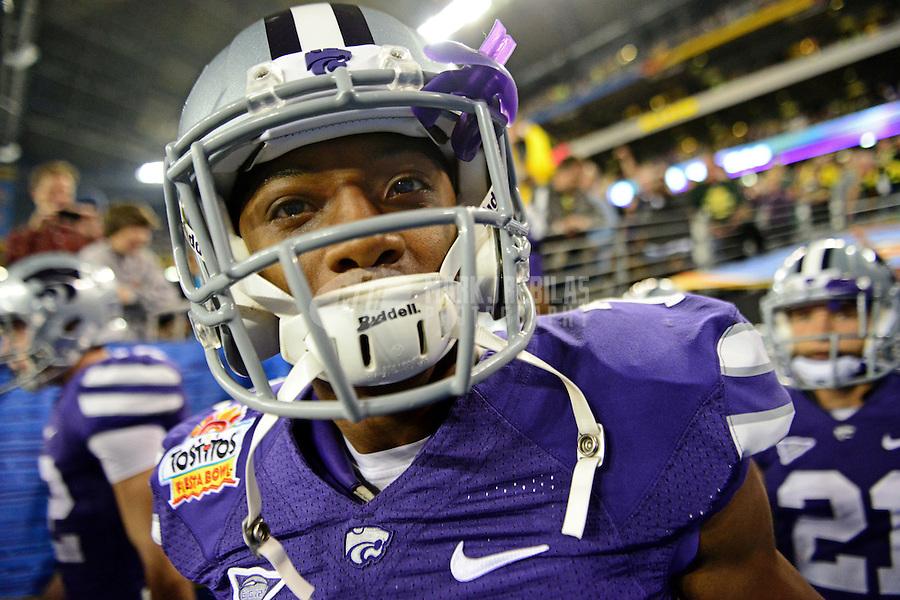 Jan. 3, 2013; Glendale, AZ, USA: Kansas State Wildcats defensive back Kip Daily (7) against the Oregon Ducks during the 2013 Fiesta Bowl at University of Phoenix Stadium. Oregon defeated Kansas State 35-17. Mandatory Credit: Mark J. Rebilas-