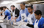 United States President Barack Obama and his daughter Sasha participate in a community service project at the D.C. Central Kitchen in commemoration of the Martin Luther King, Jr. Day of Service and in honor of Dr. King's life and legacy on Monday, January 20, 2014 in Washington DC. <br /> Credit: Olivier Douliery / Pool via CNP