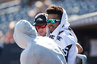 Peoria Javelinas outfielder Buddy Reed (85), of the San Diego Padres organization, talks to Braxton Davidson (34) and Lucius Fox (5) in the dugout during an Arizona Fall League game against the Glendale Desert Dogs at Peoria Sports Complex on October 22, 2018 in Peoria, Arizona. Glendale defeated Peoria 6-2. (Zachary Lucy/Four Seam Images)