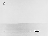 Lone fishing boat in gentle morning light on the Lake of Galilee