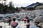 Clockwise from the far left, Carole Woodall, Dena Woodall, Vada Woodall, and Capt. Ed Meyers soak in the Mount Princeton Hot Springs a short drive from Salida. Michael Brands for The New York Times.