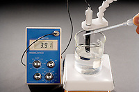 SHIFT IN pH AS BASE IS ADDED TO ACIDIC SOLUTION<br /> (1 of 3)<br /> Measured by pH Meter<br /> The pH of an acidic solution shows 3.91 on the meter.