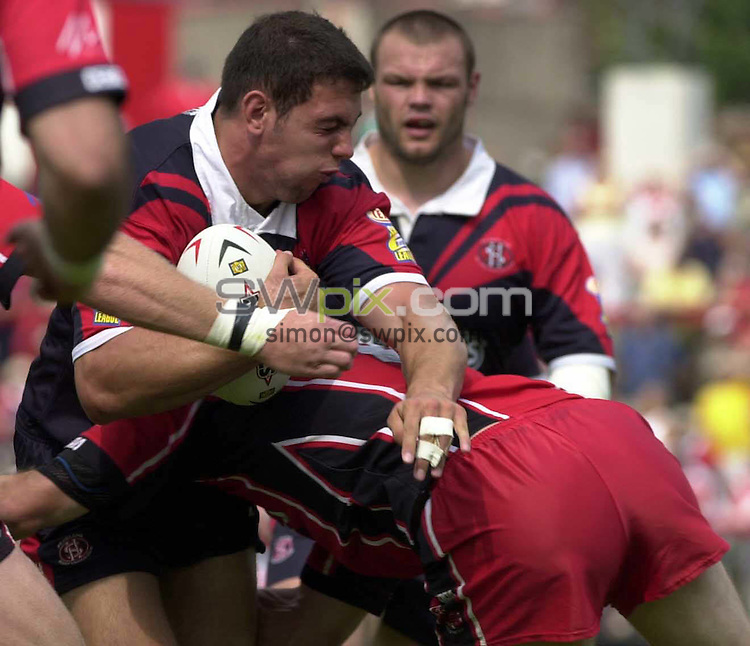 .PICTURE BY :Chris Whiteoak/SWpix.com. Rugby Super League, Salford City Reds v St Helens, Salford, 8/8/2004..?COPYRIGHT PICTURE>>SIMON WILKINSON>>0870 0920092>>..St Helens' Mike Bennett is taken out  by the Salford defence