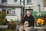 Peter Harman and his dog Chalkie at their home in Delabole, UK.