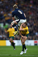 David Denton of Scotland is tackled in the air by Drew Mitchell of Australia. Rugby World Cup Quarter Final between Australia and Scotland on October 18, 2015 at Twickenham Stadium in London, England. Photo by: Patrick Khachfe / Onside Images