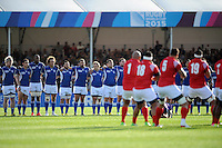 Namibia stand tall as Tonga perform their pre-match war dance, the Sipi Tau,  during Match 20 of the Rugby World Cup 2015 between Tonga and Namibia - 29/09/2015 - Sandy Park, Exeter<br /> Mandatory Credit: Rob Munro/Stewart Communications