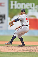 Rome Braves pitcher Carlos Salazar (55) delivers a pitch during a game against the Asheville Tourists on May 17, 2015 in Asheville, North Carolina. The Tourists defeated the Braves 9-8. (Tony Farlow/Four Seam Images)