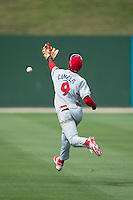 Lakewood BlueClaws shortstop Malquin Canelo (9) can't catch up to this fly ball in shallow left field during the game against the Kannapolis Intimidators at CMC-Northeast Stadium on May 17, 2015 in Kannapolis, North Carolina.  The Intimidators defeated the BlueClaws 4-1.  (Brian Westerholt/Four Seam Images)