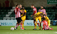 Northampton Town's Junior Morias, second in left, reacts to a challenge from Lincoln City's Tom Pett on Northampton Town's Kevin van Veen which resulted in him being shown a red card<br /> <br /> Photographer Chris Vaughan/CameraSport<br /> <br /> Emirates FA Cup First Round - Lincoln City v Northampton Town - Saturday 10th November 2018 - Sincil Bank - Lincoln<br />  <br /> World Copyright &copy; 2018 CameraSport. All rights reserved. 43 Linden Ave. Countesthorpe. Leicester. England. LE8 5PG - Tel: +44 (0) 116 277 4147 - admin@camerasport.com - www.camerasport.com