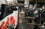 Protestors launched Silly String at the line of police during the Solidarity Against Hate rally Sunday August 13, 2017 in Seattle.