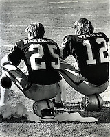 Oakland Raiders flanker Fred Biletnikoff and quarterback Ken Stabler on the sideline.(copyright 1972 Ron Riesterer)