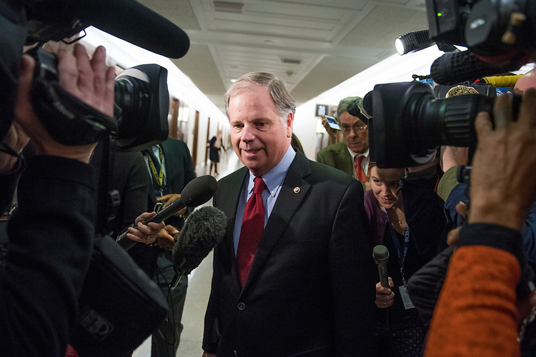 UNITED STATES - JANUARY 25: Sen. Doug Jones, D-Ala., arrives for a bipartisan meeting on immigration in the Dirksen Building office of Sen. Susan Collins, R-Maine, on January 25, 2018. (Photo By Tom Williams/CQ Roll Call)